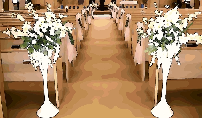 wedding flowers on church pews